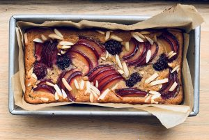 A gluten-free bread topped with seasonal fruit.
